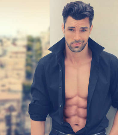 Sexy male fashion model with open shirt and nice abs photo
