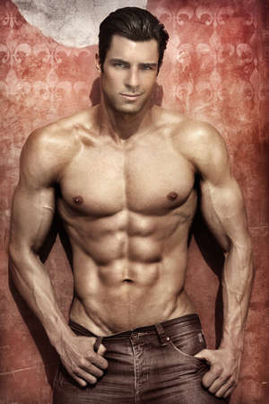 Handsome muscular man posing against vibrant elegant background photo