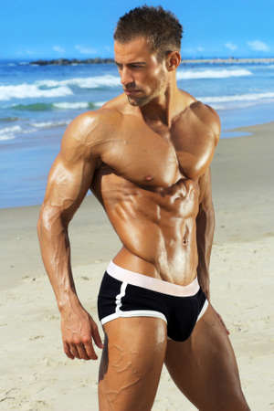 Gorgeous muscular young man at beach Stock Photo