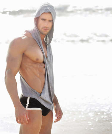 Portrait of a handsome muscular man at beach photo