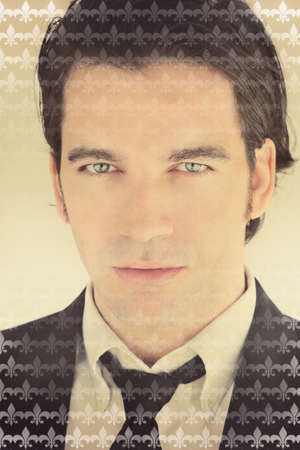 Closeup stylized fashion portrait of handsome young business man and an elegant pattern overlay effect and overall warm vintage toning