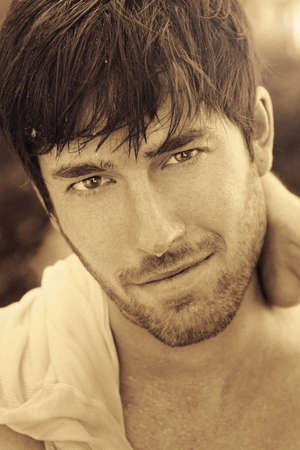 Sepia toned portrait of handsome man Foto de archivo