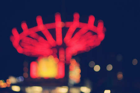 Abstract concept of a carnival at night with blurred lights