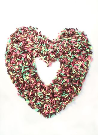 jimmies: Heart shaped spinkles on a white background
