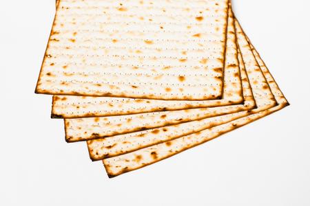 pesakh: Matzoh, jewish passover bread over white background