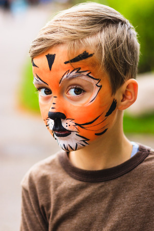 Boy with face painting tiger