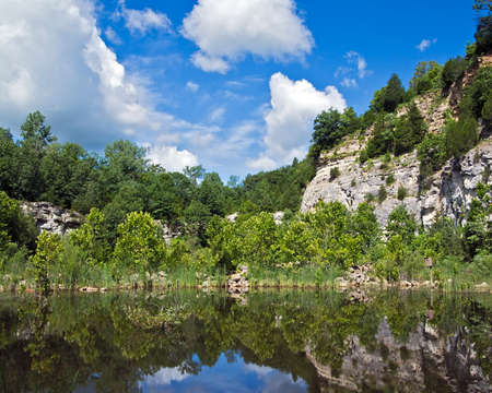 landscape of bluffs reflected in a lake Imagens