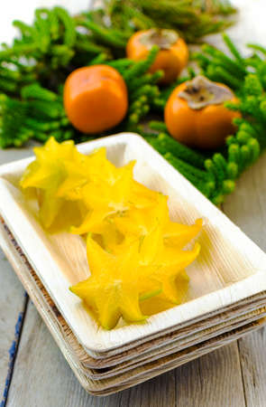 Carambola  starfruit , persimmons and araucaria photo