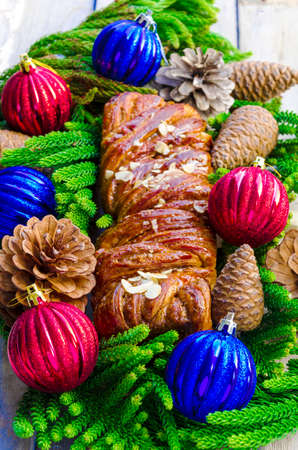 Christmas roll Yule log with almonds photo