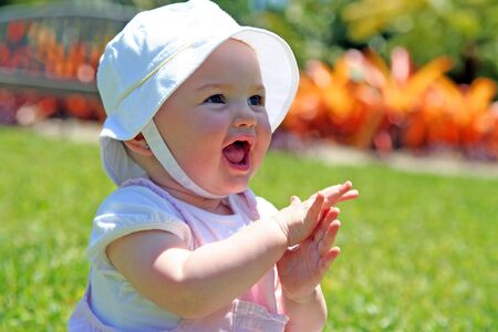 clapping hands: Happy Baby Girl Stock Photo