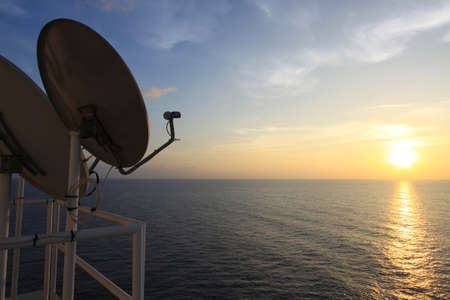 telecast: A Satellite dish on sunset time