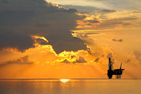Oil and Rig in sunrise time Stock Photo