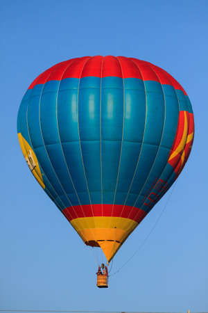 Balloon flying in the blue sky, Crews operation hot gas into balloon