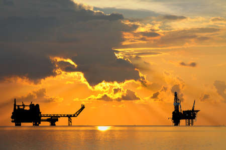 exhaust gases: Gas platform and Rig platform in sunset or sunrise time Stock Photo