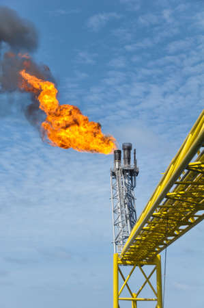 Gas burn or Flare burn in offshore location, Oil and gas process  photo