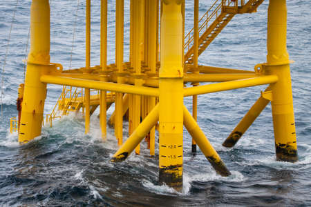 Oil and Gas Producing Slots at Offshore Platform - Oil and Gas Industry  Bad weather in offshore oil and gas platform  photo
