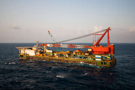 crane barge doing marine heavy lift installation works in the gulf or the sea photo