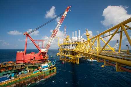 Large crane vessel installing the platform in offshore,crane barge doing marine heavy lift installation works in the gulf or the sea