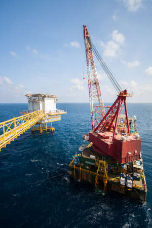 Large crane vessel installing the platform in offshore,crane barge doing marine heavy lift installation works in the gulf or the sea photo