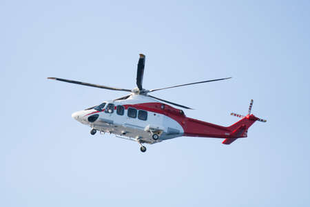 rescue helicopter flying mission in emergency, helicopter flying for transfer passenger to offshore  photo