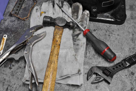 Dirty set of hand tools on table, Assorted work tools on table photo