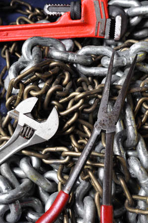 Dirty set of hand tools with chains, Industry tools in hard job  photo