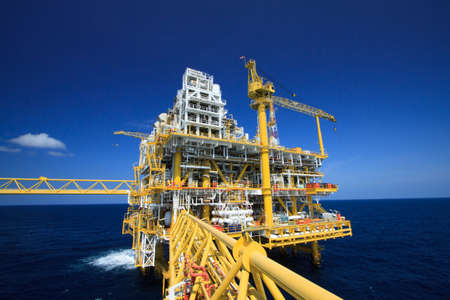 Oil and gas platform in offshore industry, Production process in petroleum industry, Construction plant of oil and gas industry  heavy work Stock Photo - 30464874