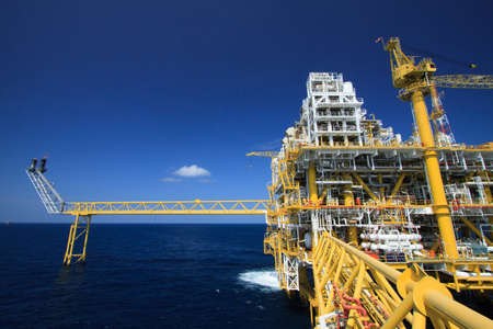 Oil and gas platform in offshore industry, Production process in petroleum industry, Construction plant of oil and gas industry  heavy work  photo
