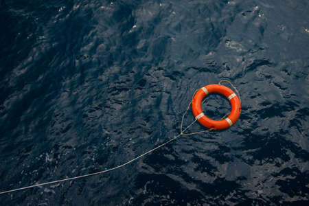 Lifebuoy in a stormy blue sea, Lifebuoy in blue sea, safety equipment in offshore or marine