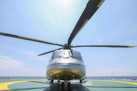 helideck: helicopter parking landing on offshore platform. Helicopter transfer crews or passenger to work in offshore oil and gas industry. Stock Photo