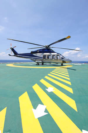 helicopter parking landing on offshore platform. Helicopter transfer crews or passenger to work in offshore oil and gas industry. photo