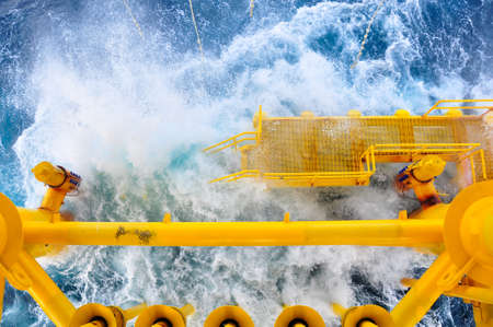 oil platform: Oil and Gas Producing Slots at Offshore Platform, The platform on bad weather condition.,Oil and Gas Industry
