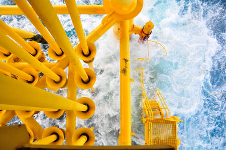 bad weather: Oil and Gas Producing Slots at Offshore Platform, The platform on bad weather condition.,Oil and Gas Industry