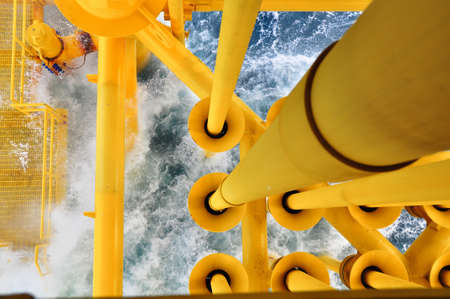oilwell: Oil and Gas Producing Slots at Offshore Platform, The platform on bad weather condition.,Oil and Gas Industry