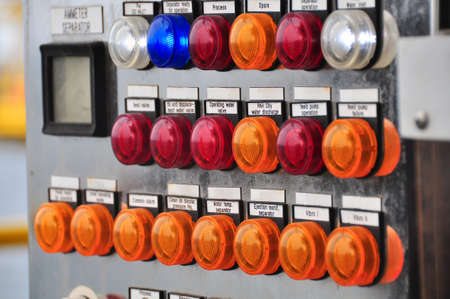 punch press: Closeup of control dials on manufacturing machinery or selector switch on control room. Stock Photo