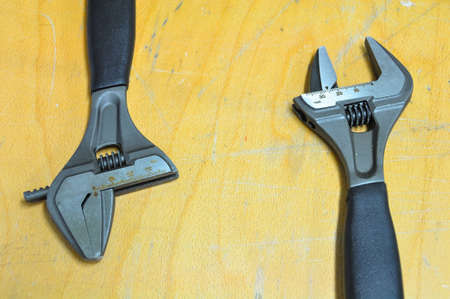set of hand tools on a wooden background, Wrench tools or Pipe wrench for hard work. photo