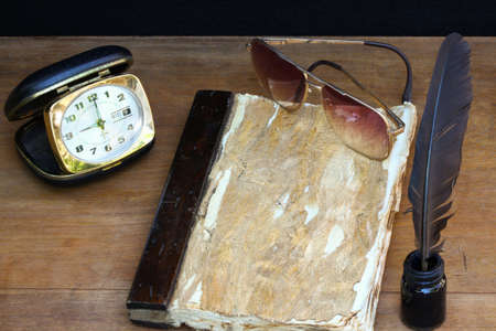 vintage memories on wooden background, Pocket book for recorded memories. photo