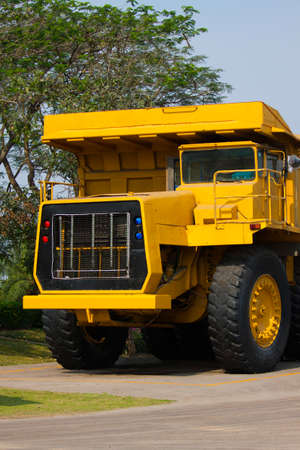 super car: Heavy mining truck in mine and driving along the opencast. Photo of the big mine truck, The career heavy-load super car.