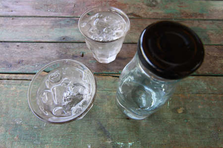 watter: Fresh water in glass on wooden table.