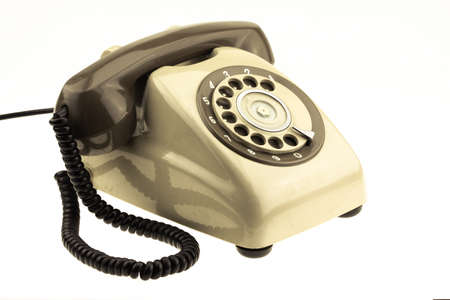 vintage picture style of new smart phone with old telephone on white background. New communication technology.