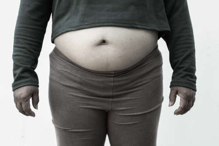 black and white picture style for Close-up of fat woman on white . Concept for obesity issue, diet of food for health.