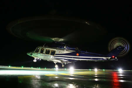 heli: Helicopter landing on oil and gas platform in night time for training. New pilot traning landing on the deck.