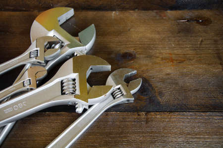 Spanner or adjustable wrench on wooden back ground, Basic hand tools. Stock Photo