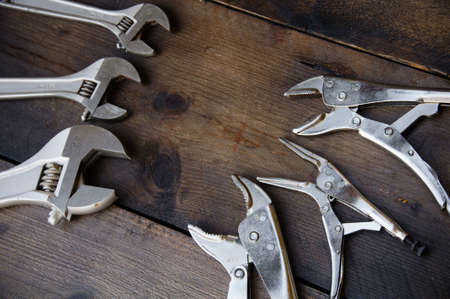 handtools: Adjustable wrench or spanner wrench and Locking pliers on wooden background, Prepare basic hand tools for work.