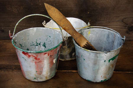 paint cans: Paint cans or paint bucket on wooden background.