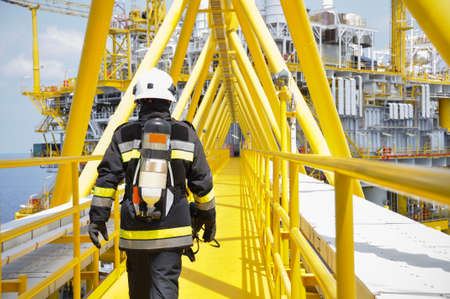 fire protection: Fire fighter on oil and gas industry, successful firefighter at work Stock Photo