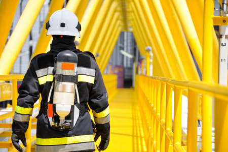 Fire fighter on oil and gas industry, successful firefighter at work Foto de archivo