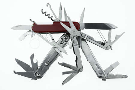 multipurpose: Pocket knife or Steel multi-function tools isolated on white background. Hand tools in industry jobs. Stock Photo