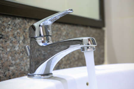 drinkable: Water drop from faucet, fresh water. equipment in rest room.