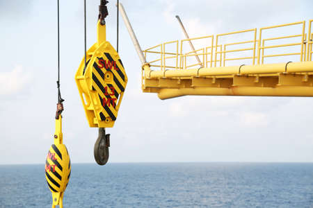 crane bucket: Crane hooks on work site, Crane on Oil and gas platform for transfer cargo and Controlled by Crane operator. Crane background and empty area for text.